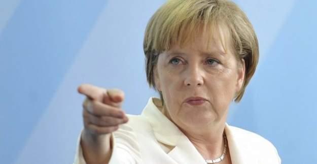 Merkel Türkiye'yi tehdit etti