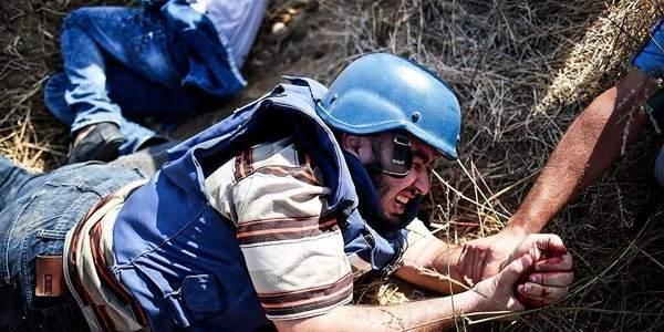 İsrail'den silahlı saldırı! AA kameramanı vuruldu.