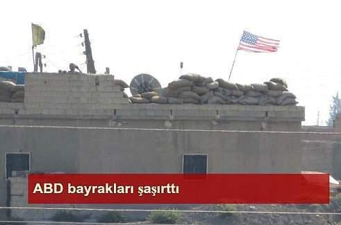 PYD denetimindeki Telabyad'da ABD bayrakları asıldı