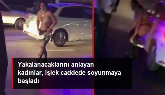 Hırsızlık şüphelisi kadınlar caddede soyunarak trafiği birbirine kattı
