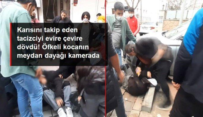 Karısını takip eden tacizciyi sokak ortasında evire çevire dövdü! Öfkeli kocanın dayağı kamerada