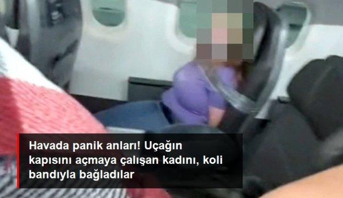 Havada panik anları! Uçağın kapısını açmaya çalışan kadını, koli bandıyla bağladılar